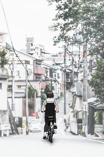 自転車に乗ってどこかに向かう女の子